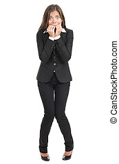 Nervous scared woman biting her nails. Funny asian businesswoman isolated in full length on white background. Mixed caucasian / chinese model.