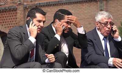 Nervous Stock Brokers On Cell During Market Crash