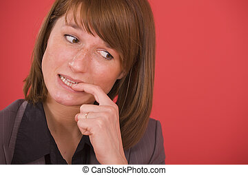 nervous woman biting nails - nervous businesswoman biting...