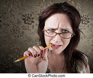 Nervous Brunette Woman Chewing on Yellow Pencil