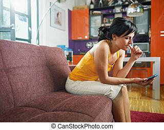 nervous woman holding cellphone