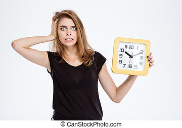 Nervous woman holding wall clock - Portrait of a nervous...