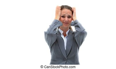 Nervous woman placing her hands on her head