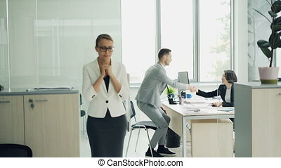 Nervous young lady is waiting for job interview standing near office biting nails and feeling insecure then walking inside and talking to manager. Youth and stress concept.