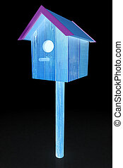 Nest box birdhouse on a black background