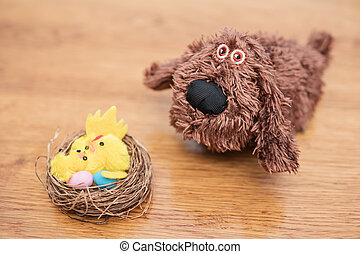 Nest with eggs and chicken next dog