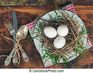 nest with the eggs on plate