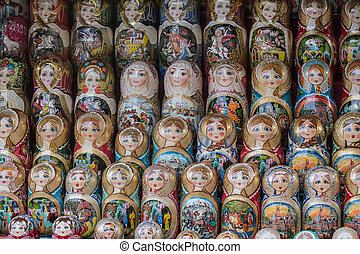 Nesting dolls on the counter in rows. National Russian toys