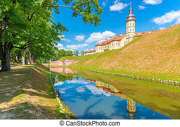 Nesvizh castle reflected in the water