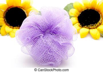 Net sponge sunflower on white background