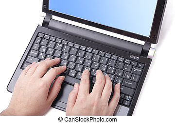 Netbook - Hand on netbook keyboard (isoleted, close up)