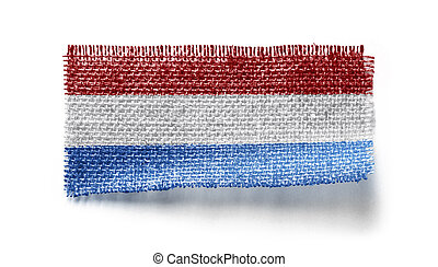 Netherlands flag on a piece of cloth on a white background