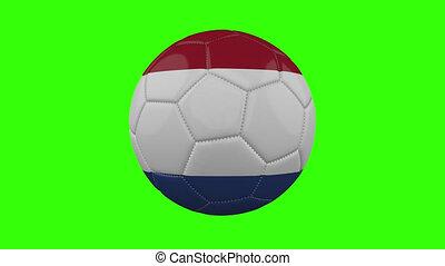 Netherlands flag on ball rotates on transparent green alpha background, loop