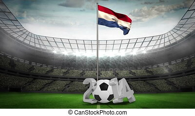 Netherlands national flag waving on pole with 2014 message on football pitch
