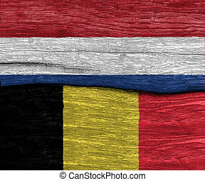nethreland and belgium flag on wood