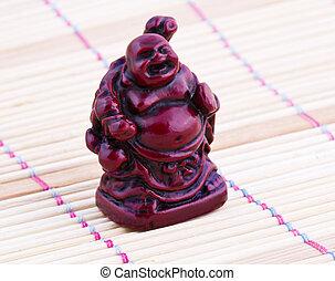 Netsuke red figure. Vintage statue. Close up