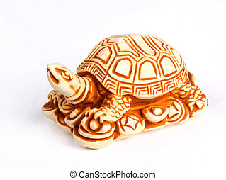 Netsuke turtle figure isolated on white background. Close-up