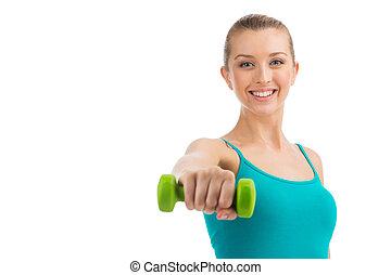 nett, lächelnde frau, trainieren, mit, dumbbells.,...