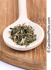 Nettle tea on a wooden spoon