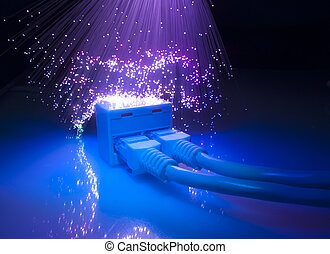 network cables and hub closeup with fiber optical background