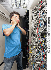 Network Cables Horror - Adult man in his early 30's looking...