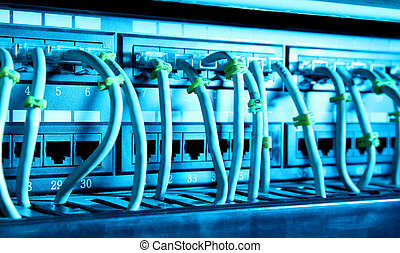 Technology - Network cables with blue light. Technology...