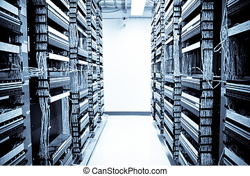 Network data center - A shot of servers and hardwares in an...