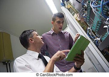 network engineers in server room