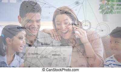 Animation of network of connections against family having a video call on laptop at home. Global online network digital interface concept digitally generated image.