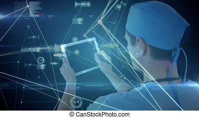 Network of connections and data processing against rear view of male surgeon using digital tablet against blue background. medicine research science and global networking concept