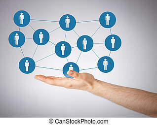 mans hand showing social network