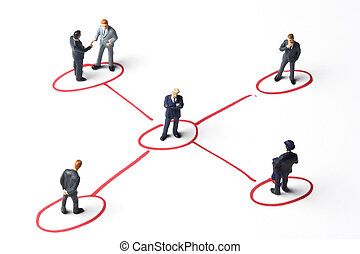 Networking - Business figures and marker on paper.