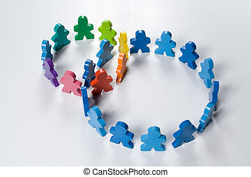 Multicolored wooden people illustrating a business concept - networking or teamwork.