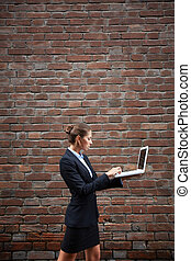 Networking on the move - Image of serious businesswoman with...
