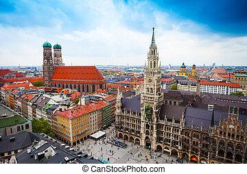 beautiful city centre view of Marienplatz, New Town Hall (Neues Rathaus), Glockenspiel, Frauenkirche with sky in Munich, (Bavaria, Germany)