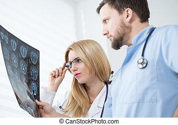 Neurologists reading brain MRI - Young neurologists reading...