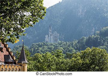 Neuschwanstein castle in bavaria view from hohenschwangau, germany cloudy mood mountain