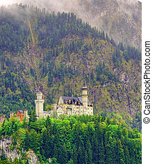 Neuschwanstein castle in the mountains of Germany