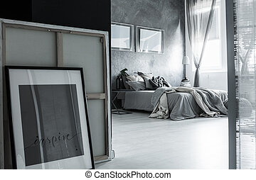 Neutral gray bedroom with posters - Close-up of bedroom in...