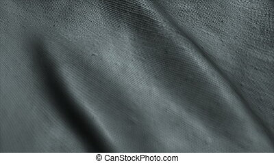 Neutral gray fabric background waving in the wind. Easy to...