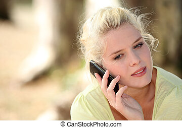 Neutral woman talking on her mobile phone