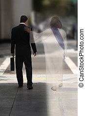 Never Alone - Double Exposure of a businessman walking down...