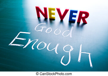 Never good enough concept, words on blackboard