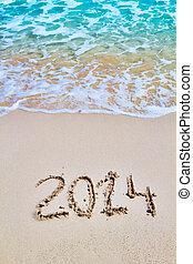 New 2014 year figures written on the sand seasonal background.