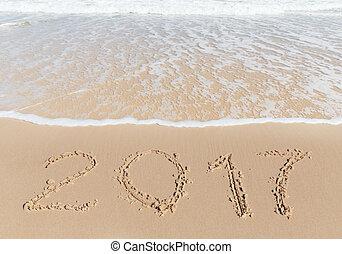 New 2017 Year sign on a sea coast sand