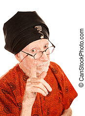 New age guru in orange shirt and black turban