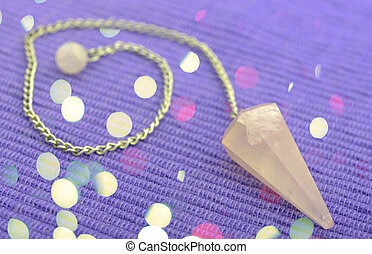 new age pendulum - new age crystal for alternative therapy
