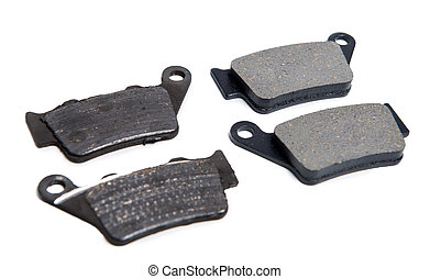 New and used brake pads for motorcycle on white - New and...