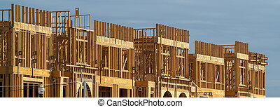 New apartment building under construction on sunny day on blue sky background