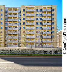 new apartment house on background of blue sky